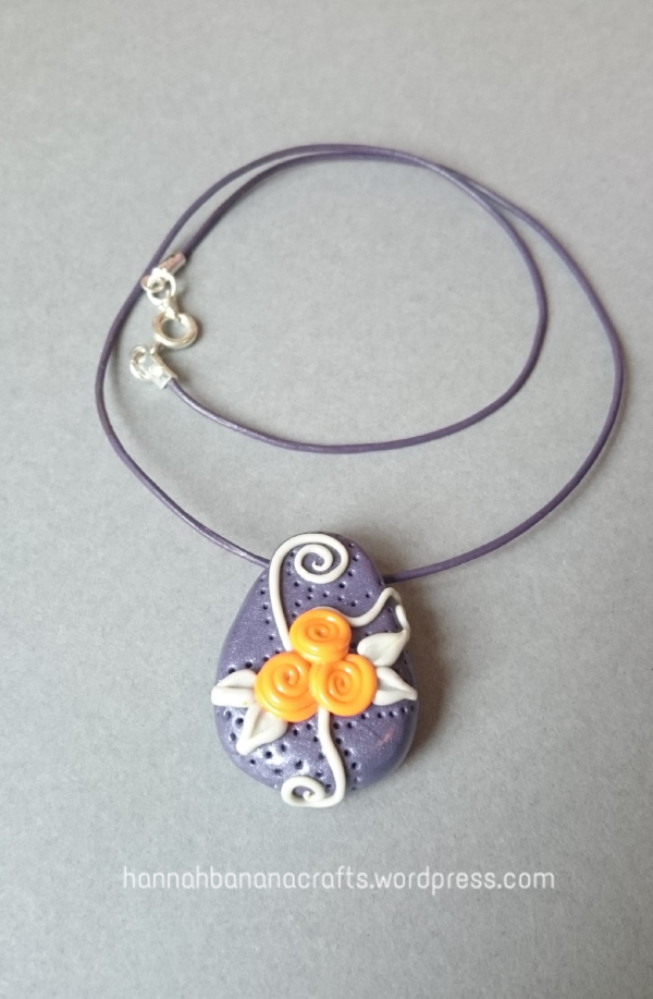 Handmade flower and swirl pendant