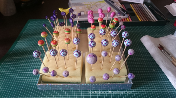 Fimo beads drying after varnishing.