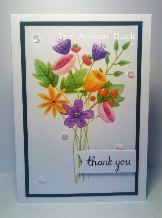 Finished card with watercolour flowers