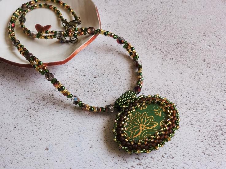 Polymer clay focal bead with beaded bezel