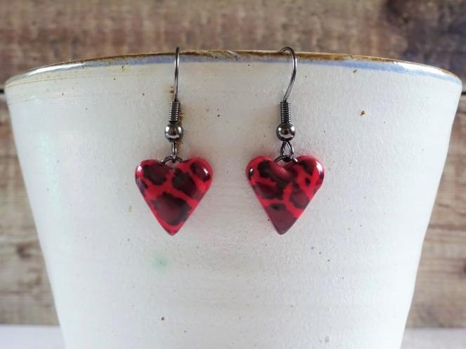 Red leopard print heart earrings