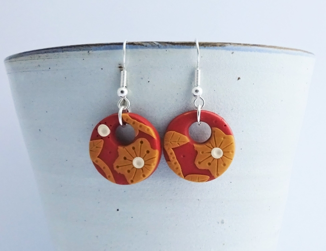 Burnt orange flower hoop earrings